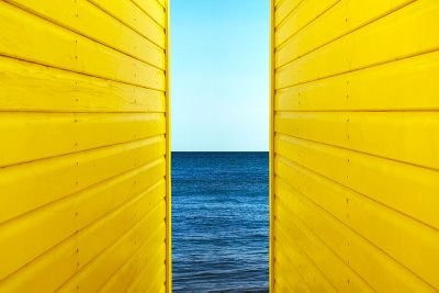 Two yellow beach huts by andy bell deceptive media
